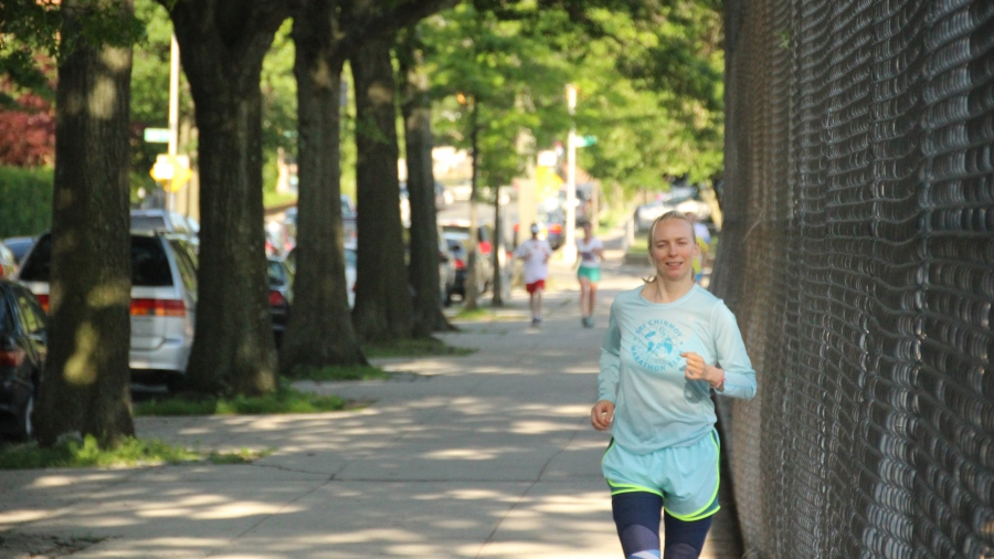Jayasalini Olga Abramovskih from Russia makes a lap on the first day of the Self-Transcendence 3100 mile race. Runners alternate the direction they go around the block each day to avoid uneven wear on their bodies.