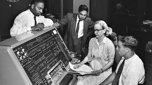 Grace Hopper sits behind the UNIVAC (universal automatic computer) keyboard in the early '60s. As a mathematician and rear admiral in the US Navy, she helped design the UNIVAC I and many other related systems.