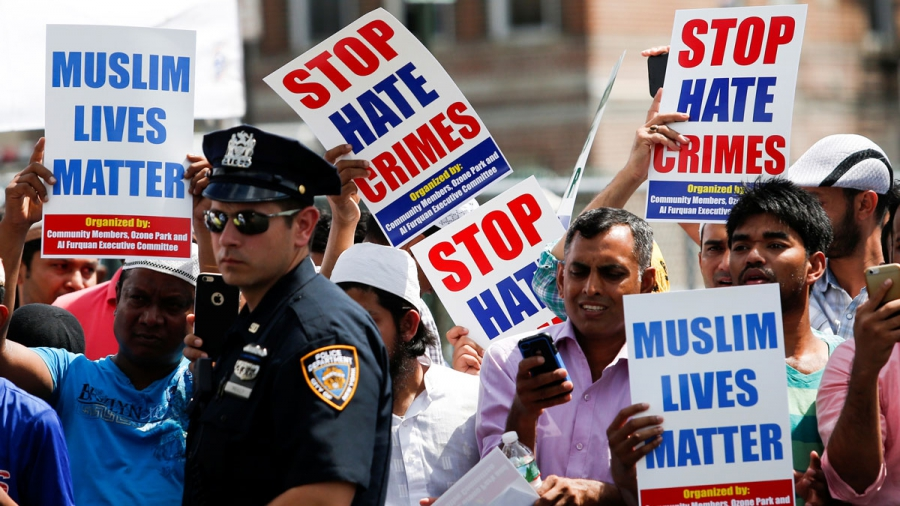 Community members take part in a protest to demand a stop hate crimes during the funeral service of Imam Maulama Akonjee, and Thara Uddin in New York City.