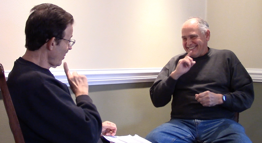 A participant, right, in the study of the ASL Philadelphia accent is interviewed by researcher Jami Fisher's father.