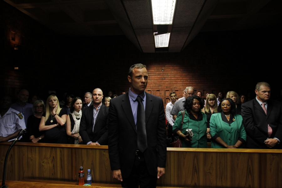 Oscar Pistorius awaits the start of court proceedings