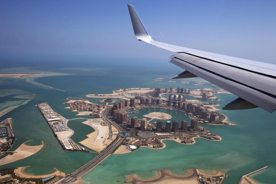 Airplane overlooking Doha.
