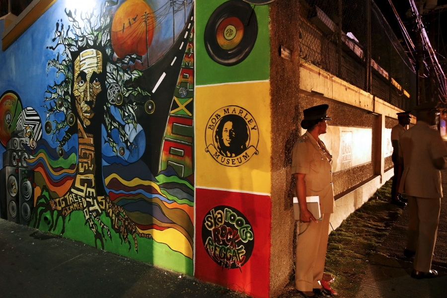 Police keep watch outside as US President Barack Obama gets a tour of the Bob Marley Museum in Kingston, Jamaica April 8, 2015.