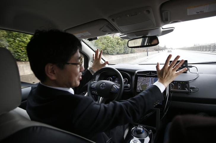 Nissan's head of automated driving, Tetsuya Lijima, sits at the controls of a modified Nissan Leaf, driverless car, during its first demonstration on public roads in London.  February 27, 2017.