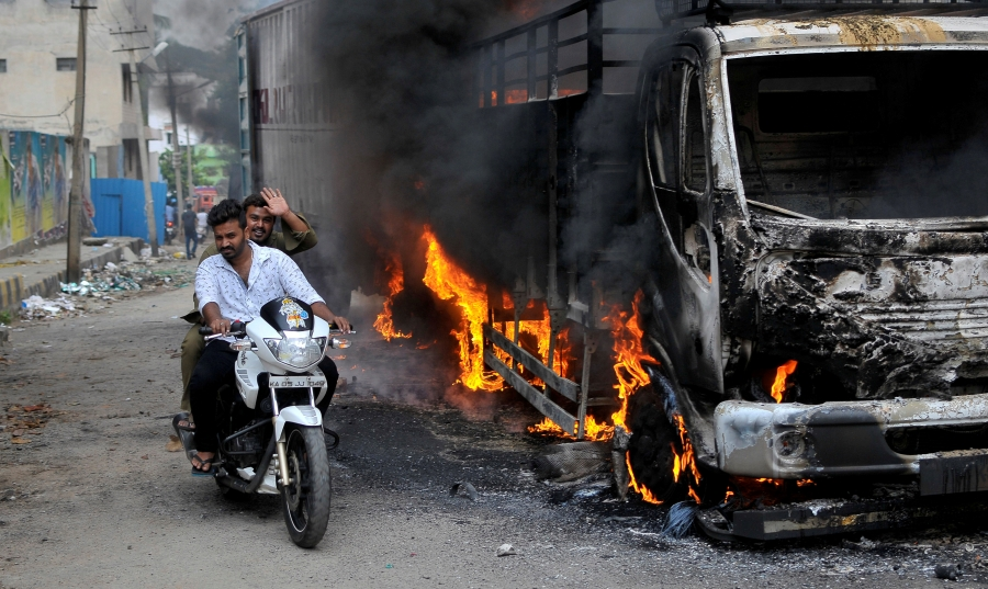 Burned bus in Bengaluru, India