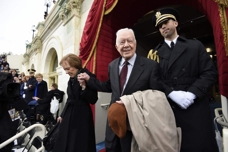 Former US President Jimmy Carter and First Lady Rosalynn Carter arrive for the Presidential Inauguration of Trump