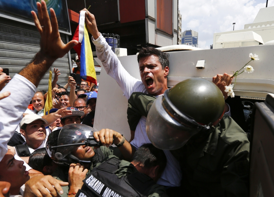 The dramatic moment, on Feb. 18, 2014, when Venezuelan opposition leader Leopoldo Lopez surrendered to National Guard in Caracas