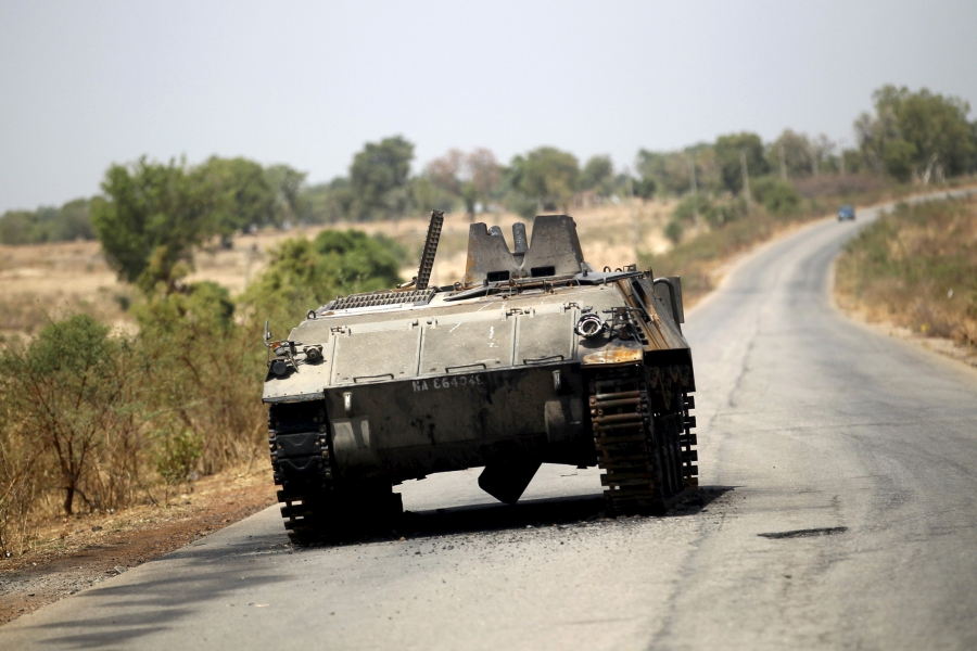 A military armoured tank is seen abandoned along a road after the Nigerian military recaptures the town of Michika from Boko Haram, Adamawa state May 10, 2015.