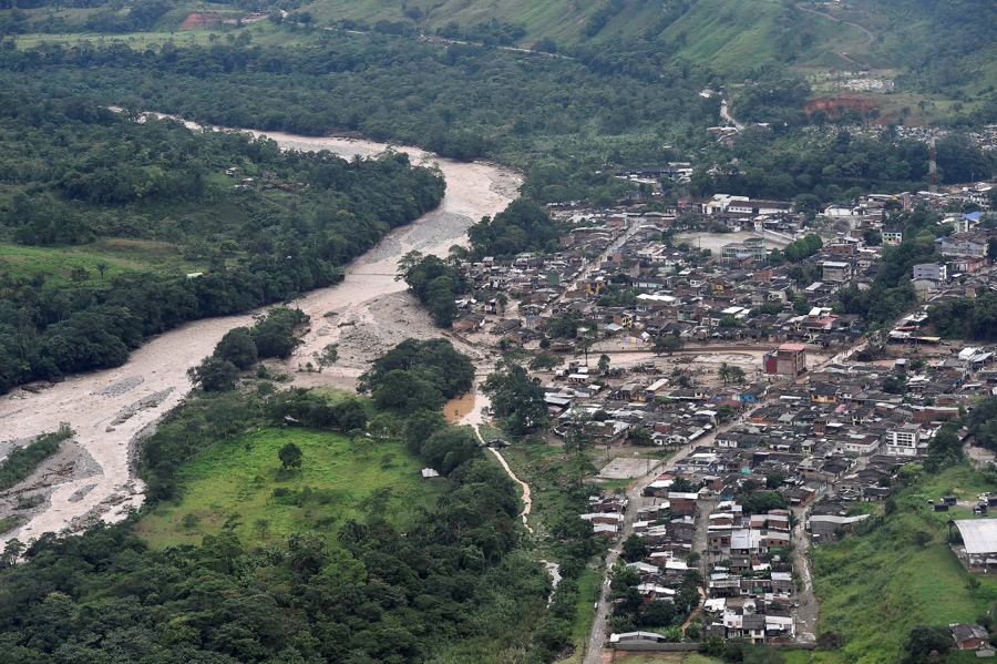 An aerial view shows a flooded area after heavy rains caused several rivers to overflow, pushing sediment and rocks into buildings and roads in Mocoa, Colombia on April 1.