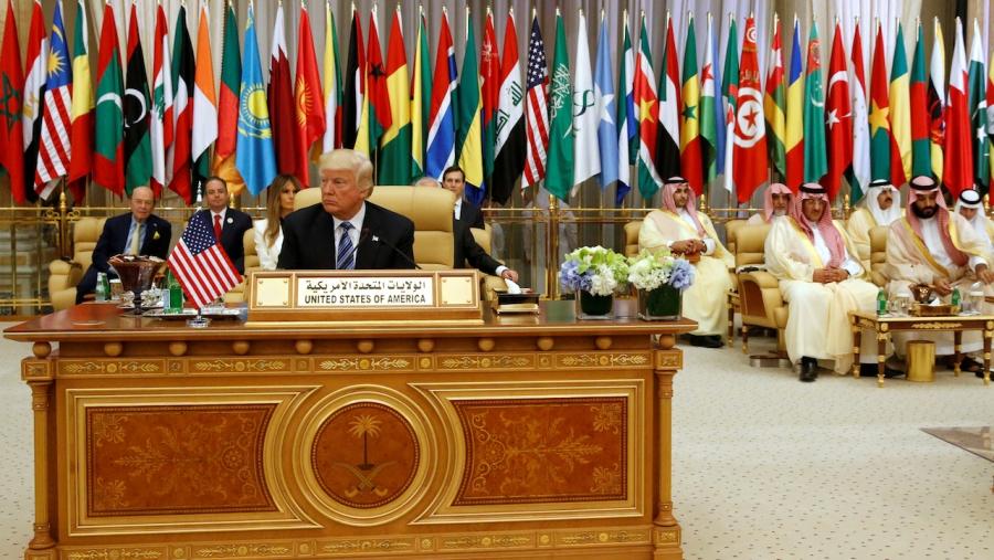 Donald Trump takes his seat before his speech to the Arab Islamic American Summit in Riyadh, Saudi Arabia, May 21, 2017.