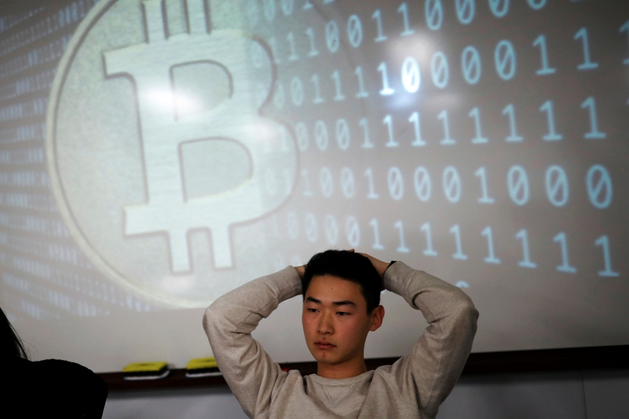 A university student, a member of a club studying cryptocurrencies, attends a meeting at a university in Seoul, South Korea, December 20, 2017.