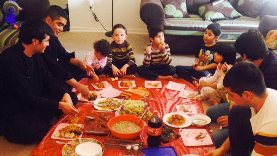 The families of former Afghan interpreters Janis Shanwari and Ajmal Faqiri gather for a holiday lunch on Thursday.