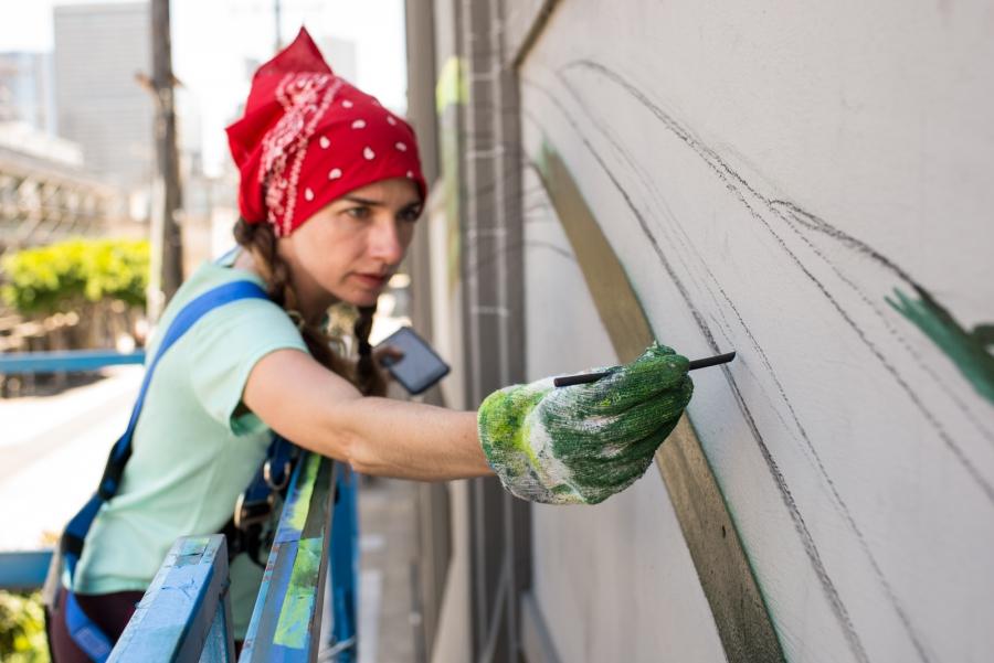 Mona Caron painting in San Francisco
