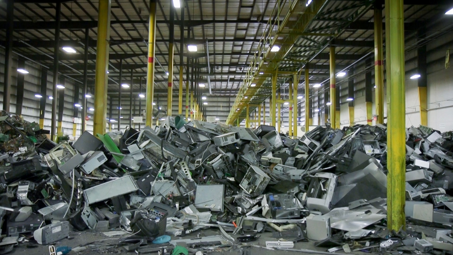 Plastics and metals from dismantled electronics await their turn to enter a machine that shreds and sorts them into commodity type.
