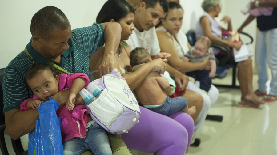 Parents wait with their children at the Fundação Altino Ventura clinic in Recife.
