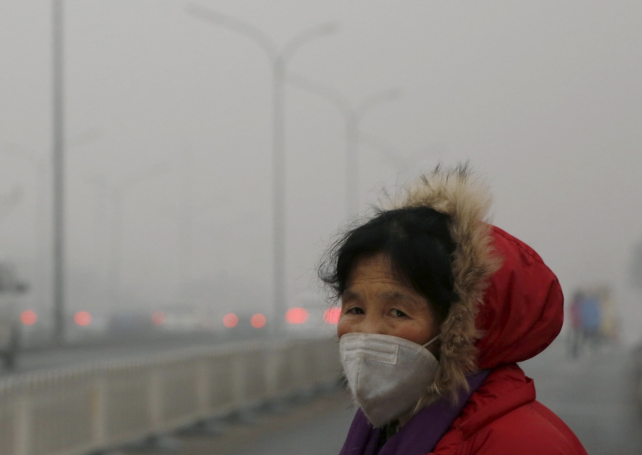 A woman wears a protective mask on one of the worst polluted days in Beijing.