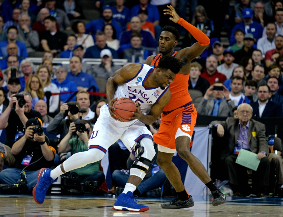 Kansas Jayhawks center Udoka Azubuike drives to the basket against Clemson Tigers forward Elijah Thomas during the first half in the semifinals of the Midwest regional of the 2018 NCAA Tournament.