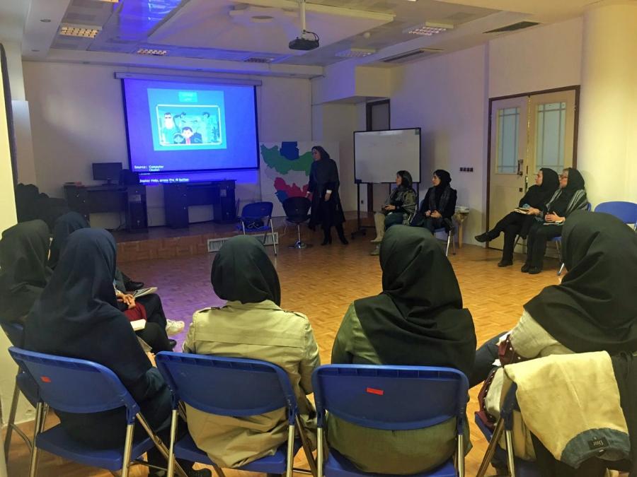 Yassi Ashki teaches a workshop for teachers at a school in Tehran.