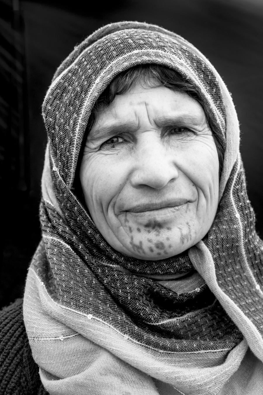 Amina Saleh--60 year-old woman from Musko, a village of Kobani, at Bulgur Fabrikası refugee camp in Suruc, Turkey, October 25, 2014. Mother of 6, she got her face tattooed when she was about 10 years old.