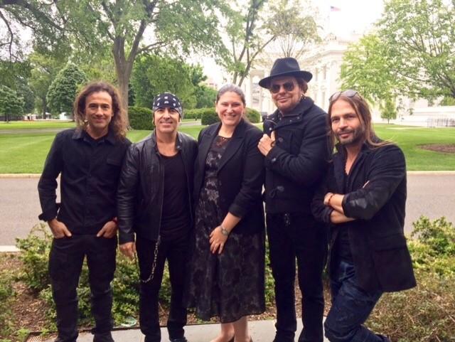 Gabriela Chojkier, Senior Director of Hispanic Media at the White House, poses with Latin rock band Mana