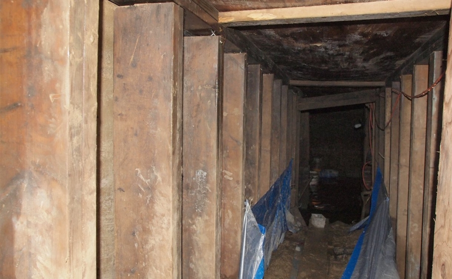 A 33-foot-long tunnel supported using lumber.