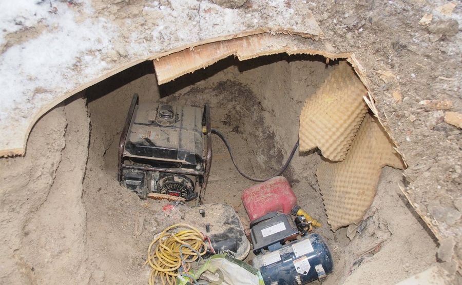 A generator discovered buried nearby that supplied electricity to the tunnel via a buried power supply.