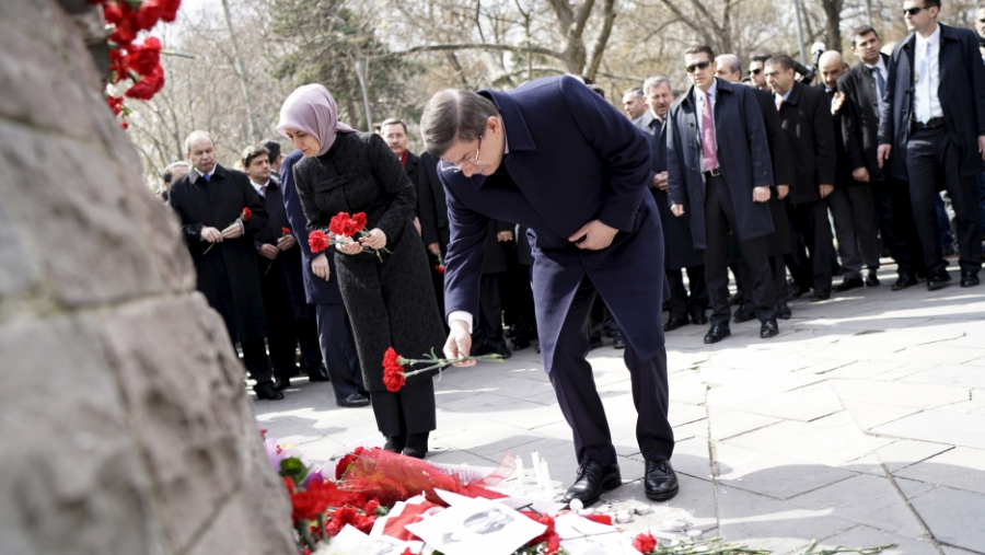 Turkish Prime Minister Ahmet Davutoglu and his wife Sare Davutoglu place carnations at the site of Sunday's suicide bomb attack, in Ankara, Turkey March 17, 2016.