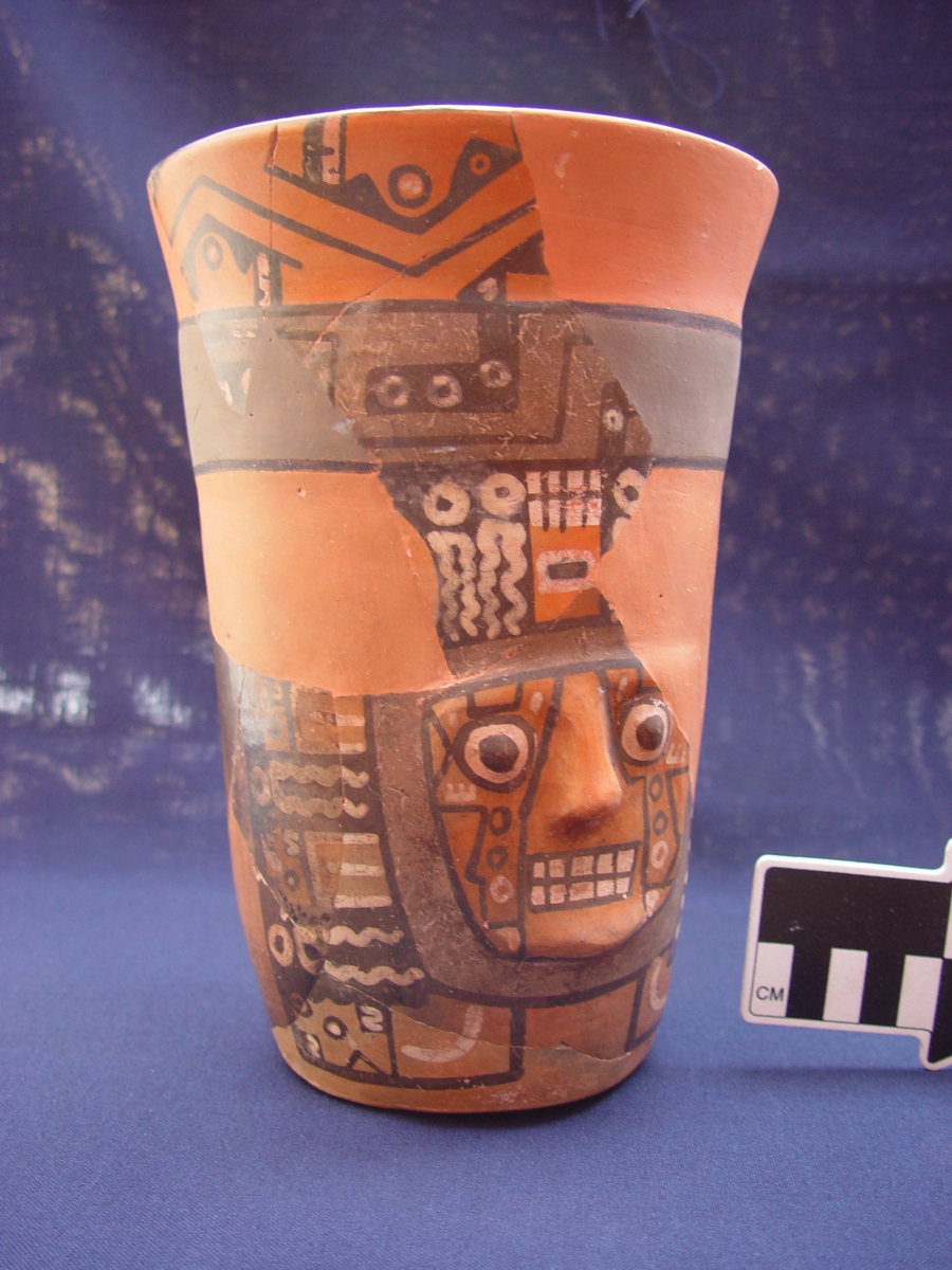 A Wari drinking vessel from Cerro Baul with a half-gallon capacity, depicting the face of a principal Wari deity. Courtesy of the Cerro Baul Archaeological Project