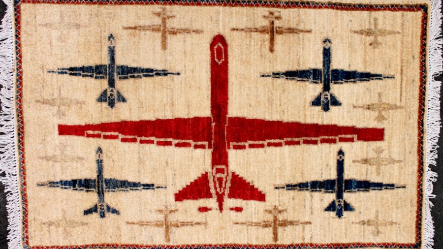 Reaper drones appear on this rug which was hand-woven in Pakistan.