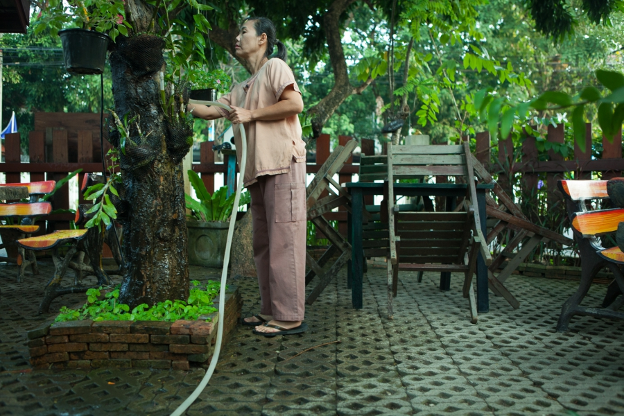 Inmates take care of the Center grounds each morning before customers arrive.