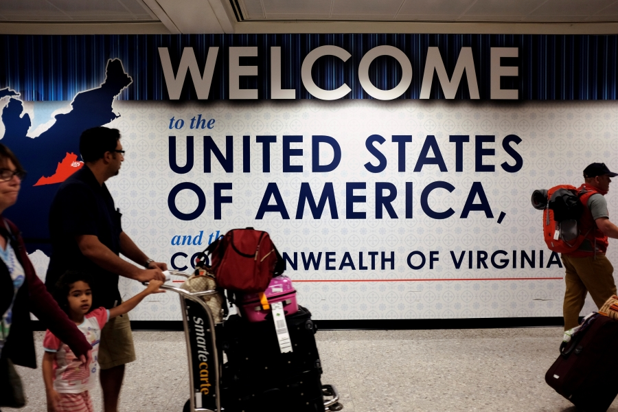 A family exits after clearing immigration and customs at Dulles International Airport