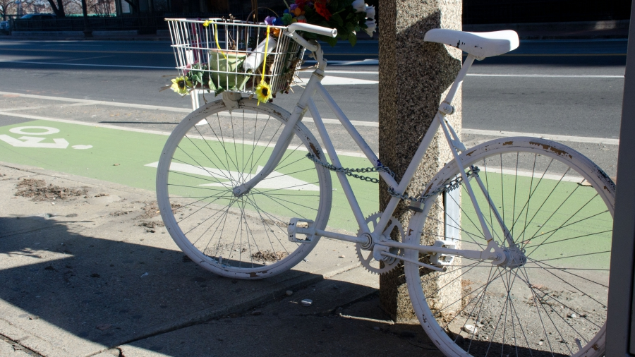 "A ""ghost bike"" memorial in Boston marks where surgeon Anita Kurmann was struck and killed by a truck."