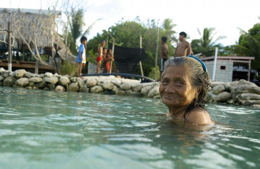 Woman swimming in Kiribati.