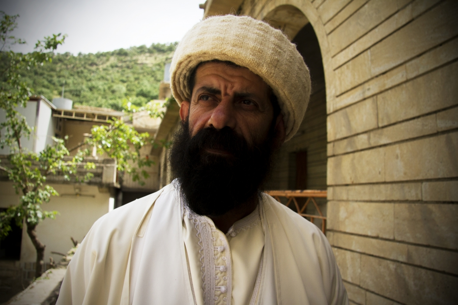 Baba Chawish, a Yezidi spiritual leader at Lalish temple, explains that before the Islamic State crisis, women who had been raped or forced to convert were traditionally cast out of Yezidi society. But now they can still be purified and baptized.