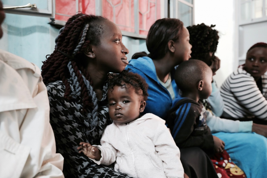 Young women waiting to be seen at the Family Health Options Kenya