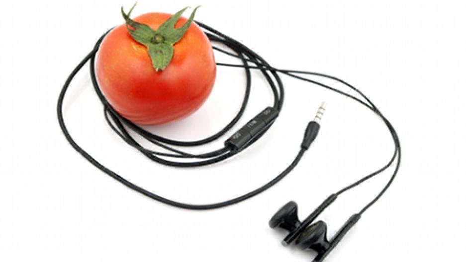A tomato with headphones
