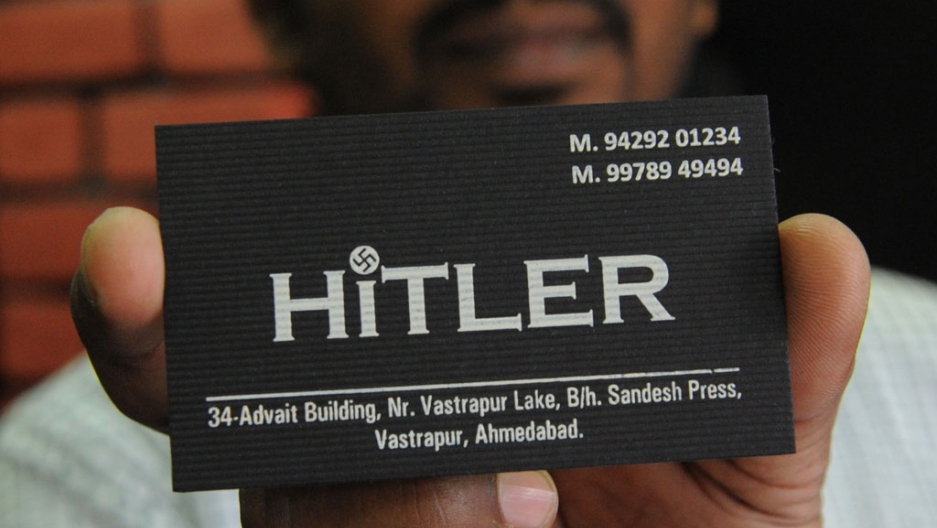Hitler clothing store in india honest mistake owner says public one of the two indian owners of the hitler clothing store rajesh shah poses with a card at his shop in ahmedabad on august 28 2012 reheart Choice Image