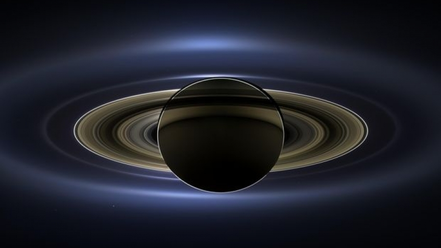 The planet Saturn is seen backlit by the sun, as seen from the Cassini spacecraft on July 19, 2013.