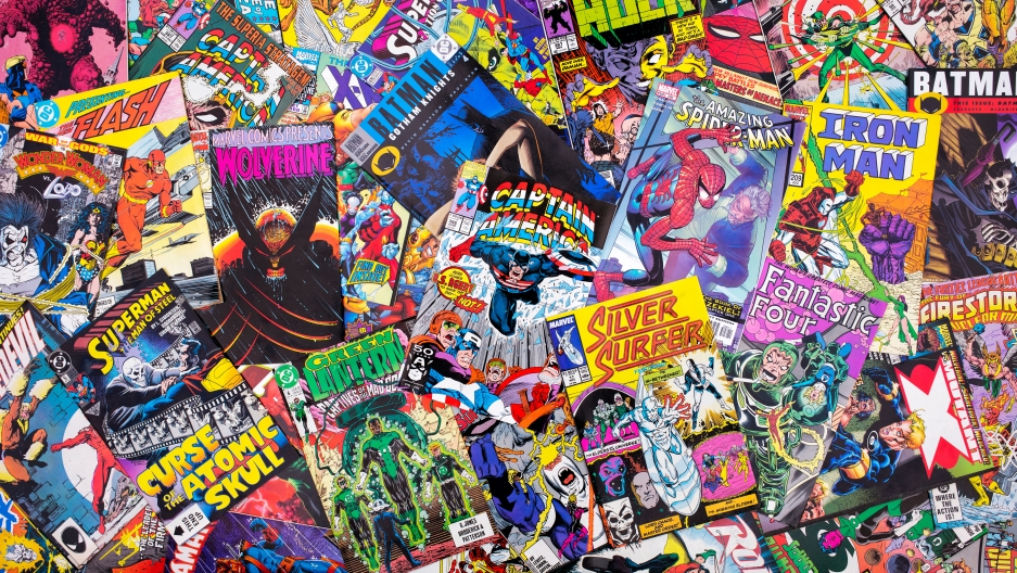 A pile of Marvel and DC comics.