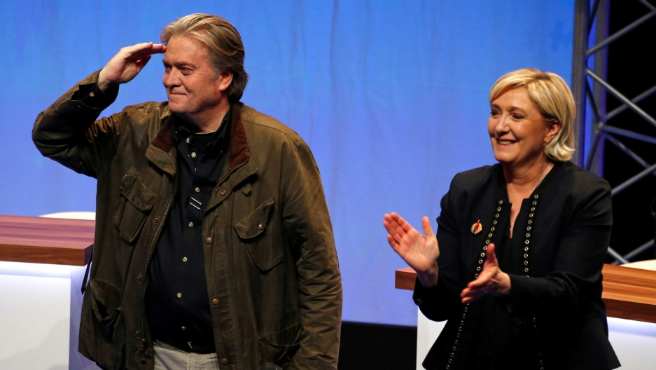 Marine Le Pen, National Front political party leader (right), and Former White House Chief Strategist Steve Bannon attend the party's convention in Lille, France, March 10, 2018.