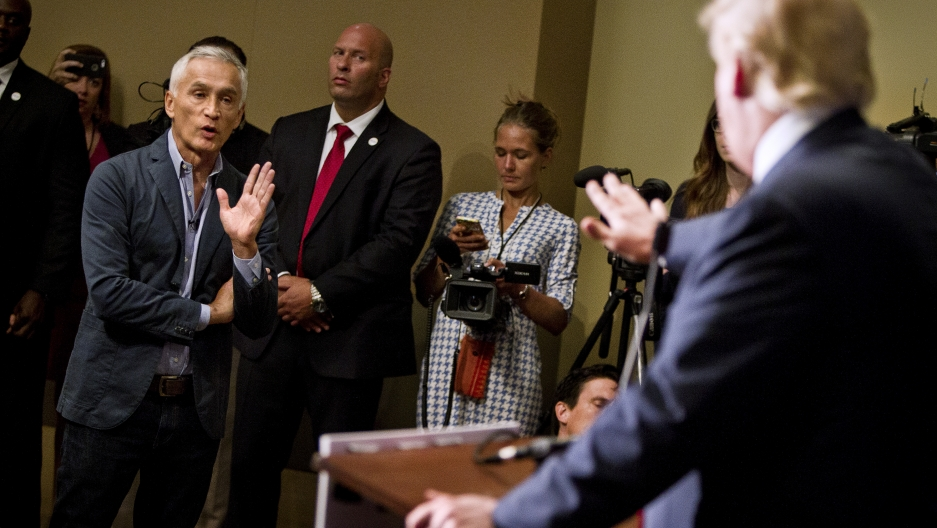 Then Republican presidential candidate Donald Trump spars with Univision reporter Jorge Ramos in Dubuque, Iowa, August 25, 2015. Ramos was removed from Trump's news conference.