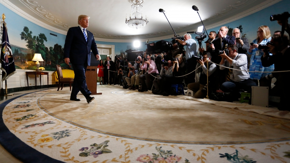 President Donald Trump walks away from the podium after announcing his intention to withdraw from the Iran nuclear agreement, May 8, 2018.