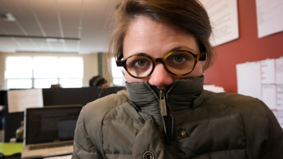 WESA reporter Margaret Krauss bundles up at the Community Broadcast Center in Pittsburgh, August 6, 2015. (Photo: Lou Blouin)