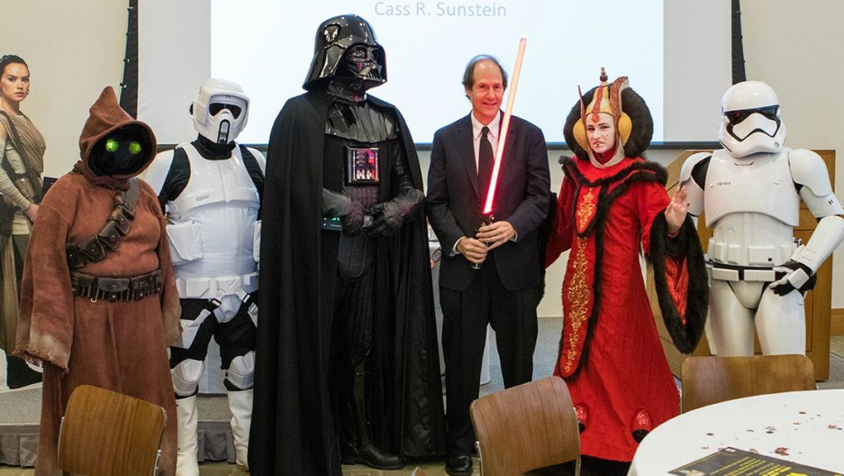 "Cass Sunstein posing with Harvard students dressed as ""Star Wars"" characters after a lecture (Lorin Granger )"