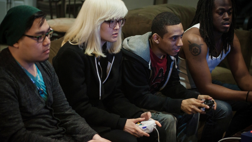 Two two-person teams battle each other in Super Smash Brothers Melee for practice.