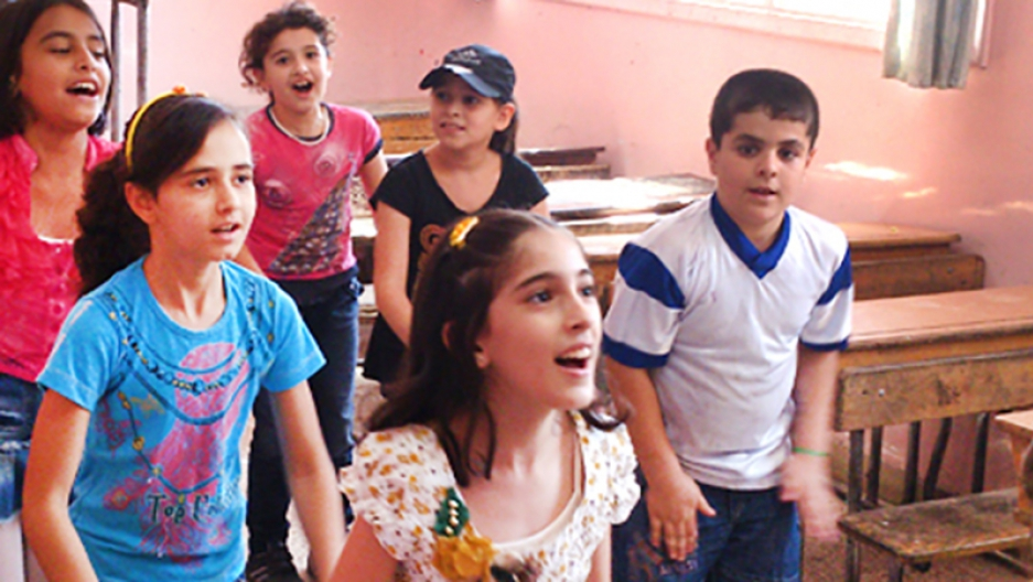 Syrian children play during a Questscope informal education class in Damascus.