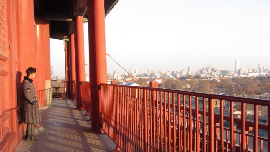 A modern skyline of a city of ambition, seen from Beijing's ancient drum tower