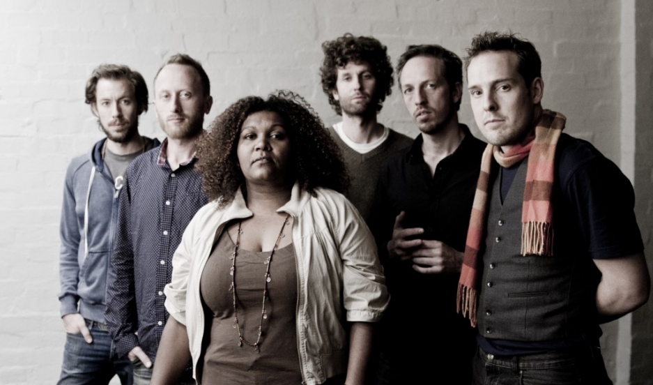 A photo of indigenous Australian singer Emma Donovan and The Putbacks, the Melbourne-based band that backs her.