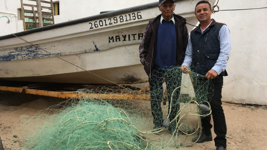 Tito Monrroy and his son Rigoberto are lifelong fishermen in Mexico's Gulf of California but restrictions to protect endangered species have made it difficult for them to get permits. The younger Monrroy now works at a fruit market. Others in and around t