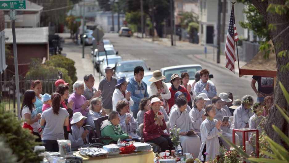 For years, only a piece of scrap metal covered the Buddha, but in July some Vietnamese immigrants in Oakland upgraded the shrine. Here, Vietnamese immigrants celebrate a Buddhist holiday with a special ceremony in the Oakland neighborhood.
